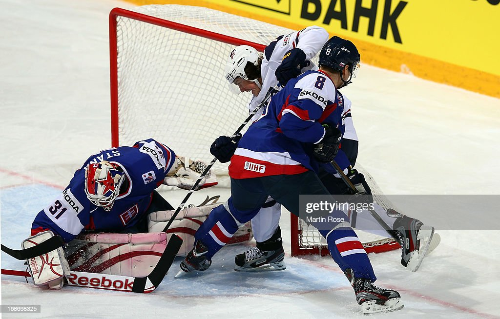 Rastislav Stana (#31), goaltender of Slovakia makes a save on TJ Oshie (C) of USA during the IIHF World Championship group H match between Slovakia and USA at Hartwall Areena on May 14, 2013 in Helsinki, Finland.