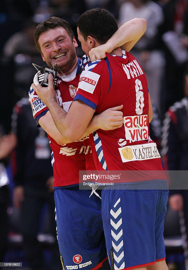 Rastko Stojkovic (L) and Marko Vujin (R) of Serbia celebrate victory against Sweden during the Men's European Handball Championship 2012 second round group one match between Serbia and Sweden at Arena Hall on January 23, 2012 in Belgrade, Serbia.