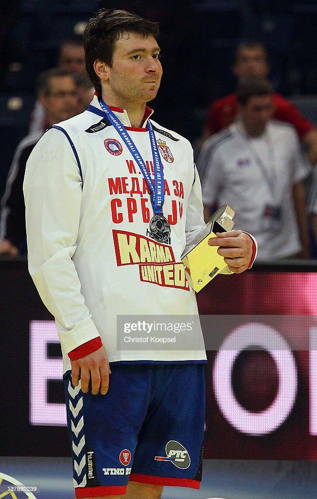 Rastko Stojkovic of Serbia looks dejected on the podium after losing 19-21 the Men's European Handball Championship final match between Serbia and Denmark at Beogradska Arena on January 29, 2012 in Belgrade, Serbia.