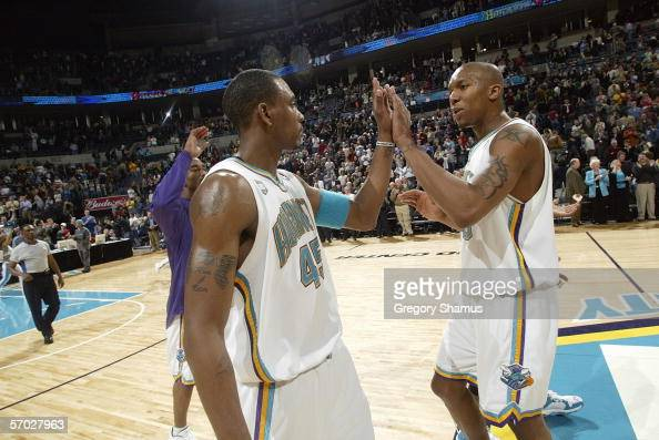 Rasual Butler and David West of the New Orleans/Oklahoma City Hornets high five during the game against the Seattle SuperSonics during a NBA game on...