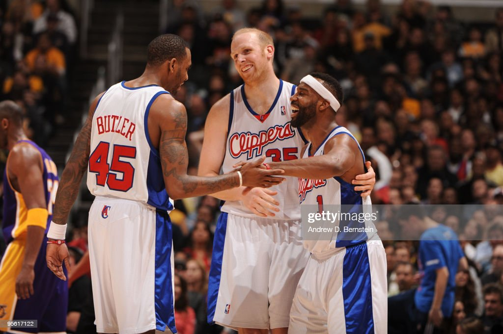 Rasual Butler #45, Chris Kaman #35, and Baron Davis #1 of the Los Angeles Clippers share a laugh during a game against the Los Angeles Lakers at Staples Center on January 6, 2010 in Los Angeles, California.