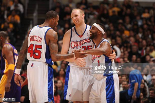 Rasual Butler Chris Kaman and Baron Davis of the Los Angeles Clippers share a laugh during a game against the Los Angeles Lakers at Staples Center on...