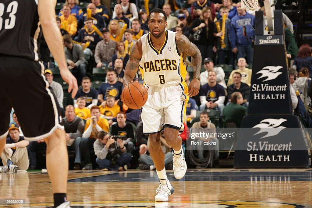 <a gi-track='captionPersonalityLinkClicked' href=/galleries/search?phrase=Rasual+Butler&family=editorial&specificpeople=201641 ng-click='$event.stopPropagation()'>Rasual Butler</a> #8 of the Indiana Pacers dribbles the ball against the Brooklyn Nets at Bankers Life Fieldhouse on December 28, 2013 in Indianapolis, Indiana.