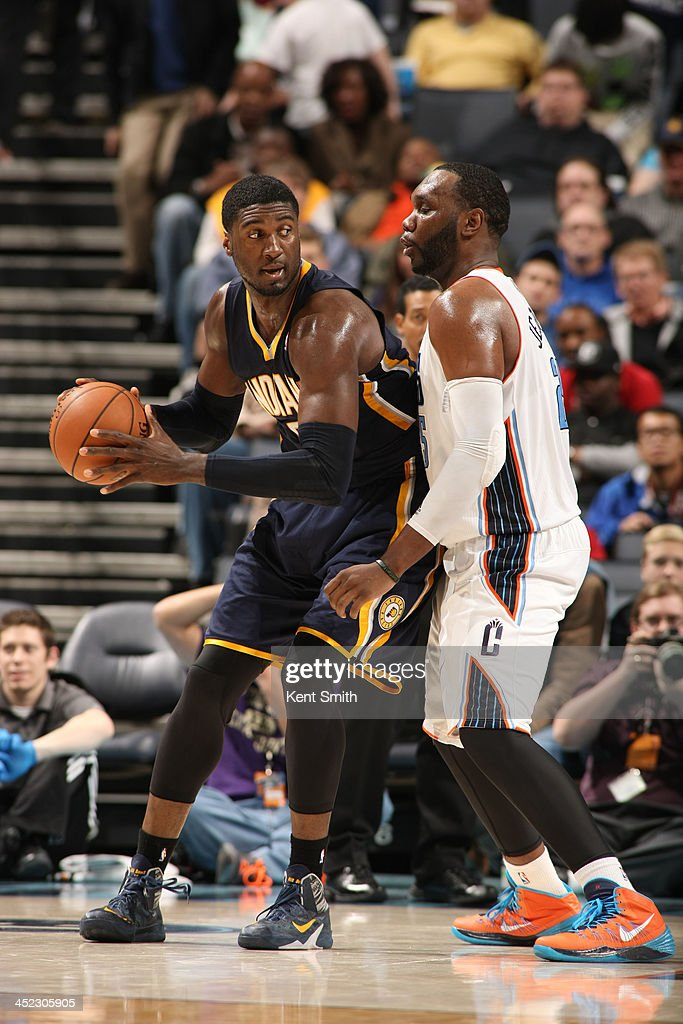<a gi-track='captionPersonalityLinkClicked' href=/galleries/search?phrase=Rasual+Butler&family=editorial&specificpeople=201641 ng-click='$event.stopPropagation()'>Rasual Butler</a> #8 of the Indiana Pacers drives against <a gi-track='captionPersonalityLinkClicked' href=/galleries/search?phrase=Al+Jefferson&family=editorial&specificpeople=201604 ng-click='$event.stopPropagation()'>Al Jefferson</a> #25 of the Charlotte Bobcats during the game at the Time Warner Cable Arena on November 27, 2013 in Charlotte, North Carolina.