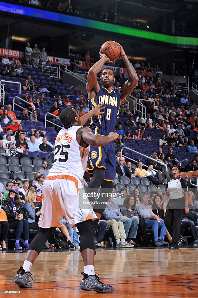 <a gi-track='captionPersonalityLinkClicked' href=/galleries/search?phrase=Rasual+Butler&family=editorial&specificpeople=201641 ng-click='$event.stopPropagation()'>Rasual Butler</a> #8 of the Indiana Pacers shoots against the Phoenix Suns on January 22, 2014 at U.S. Airways Center in Phoenix, Arizona.