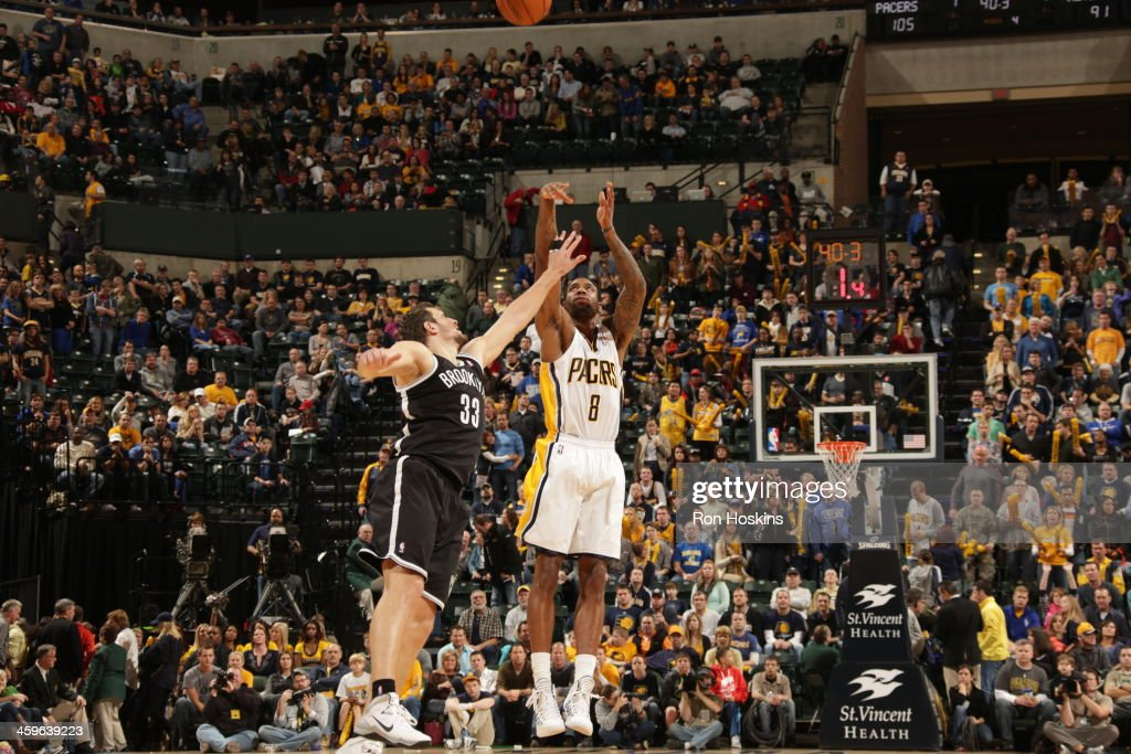 <a gi-track='captionPersonalityLinkClicked' href=/galleries/search?phrase=Rasual+Butler&family=editorial&specificpeople=201641 ng-click='$event.stopPropagation()'>Rasual Butler</a> #8 of the Indiana Pacers shoots the ball against the Brooklyn Nets at Bankers Life Fieldhouse on December 28, 2013 in Indianapolis, Indiana.