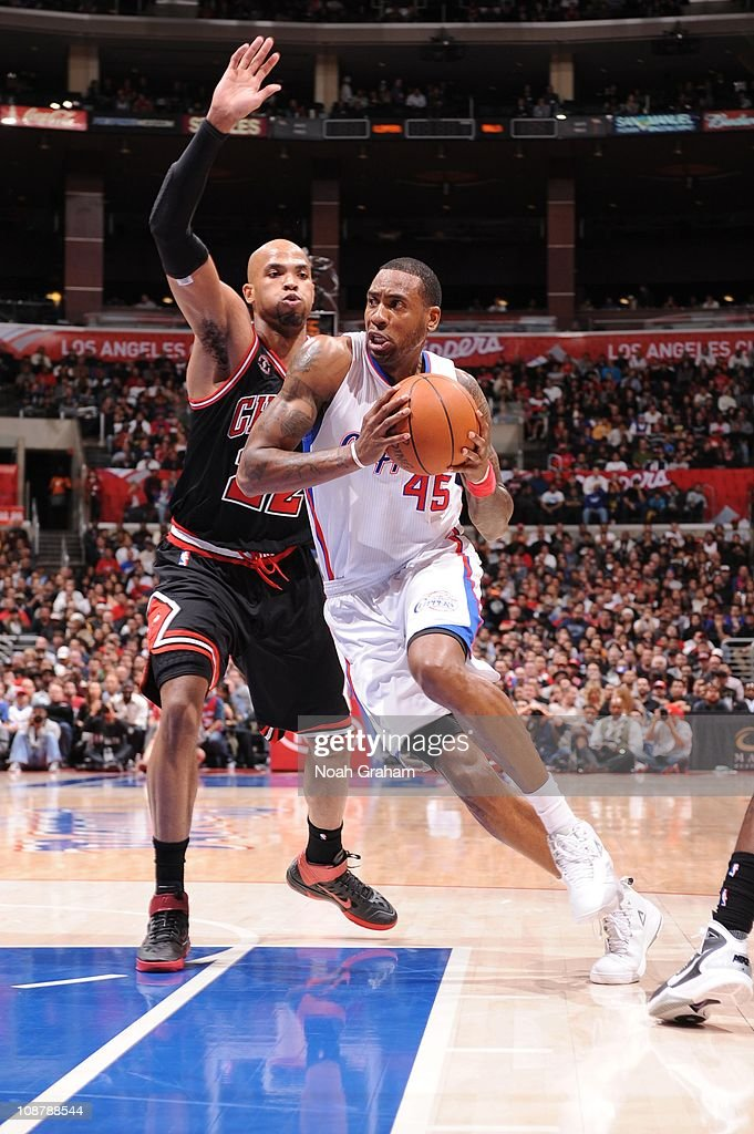 <a gi-track='captionPersonalityLinkClicked' href=/galleries/search?phrase=Rasual+Butler&family=editorial&specificpeople=201641 ng-click='$event.stopPropagation()'>Rasual Butler</a> #45 of the Los Angeles Clippers goes to the basket against <a gi-track='captionPersonalityLinkClicked' href=/galleries/search?phrase=Taj+Gibson&family=editorial&specificpeople=4029461 ng-click='$event.stopPropagation()'>Taj Gibson</a> #22 of the Chicago Bulls at Staples Center on February 2, 2011 in Los Angeles, California.