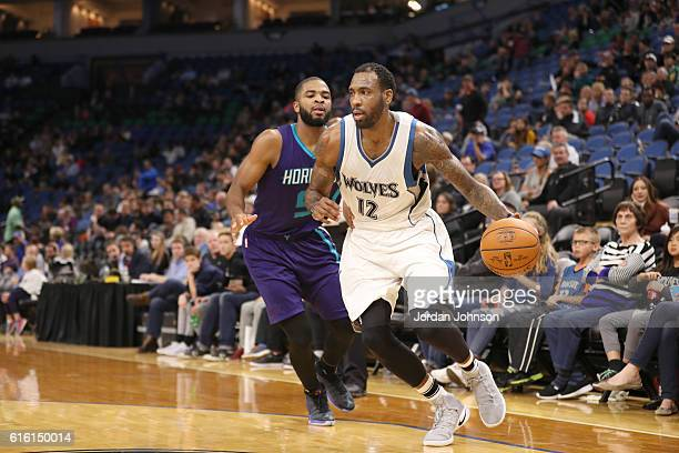 Rasual Butler of the Minnesota Timberwolves handles the ball against the Charlotte Hornets on October 21 2016 at Target Center in Minneapolis...