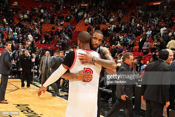 Rasual Butler of the San Antonio Spurs and Dwyane Wade of the Miami Heat hug after the game on February 9 2016 at American Airlines Arena in Miami...
