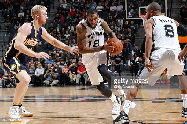 Rasual Butler of the San Antonio Spurs drives to the basket against the Indiana Pacers on December 21 2015 at the ATT Center in San Antonio Texas...