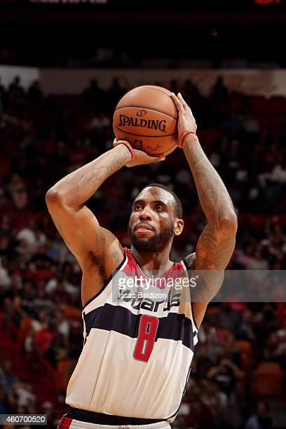 Rasual Butler of the Washington Wizards attempts a free throw against the Miami Heat on December 19 2014 at American Airlines Arena in Miami Florida...