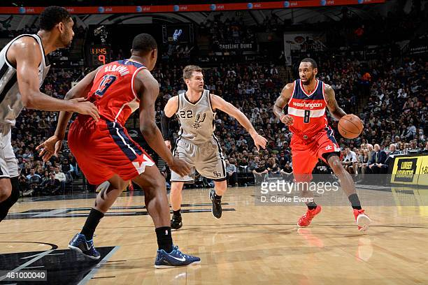 Rasual Butler of the Washington Wizards drives to the basket against the San Antonio Spurs during the game on January 3 2015 at ATT Center in San...