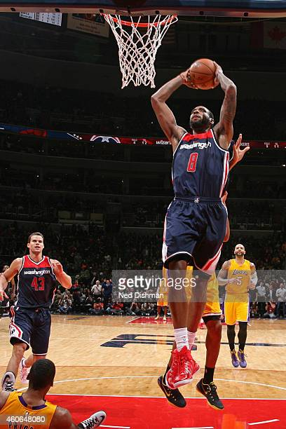Rasual Butler of the Washington Wizards dunks against the Los Angeles Lakers at the Verizon Center on December 3 2014 in Washington DC NOTE TO USER...
