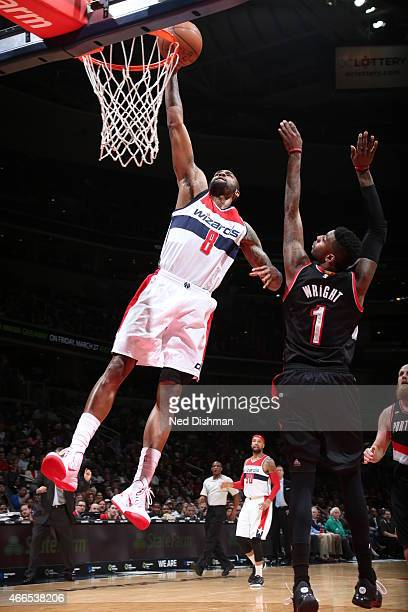 Rasual Butler of the Washington Wizards goes to the basket against Dorell Wright of the Portland Trail Blazers on March 16 2015 at the Verizon Center...
