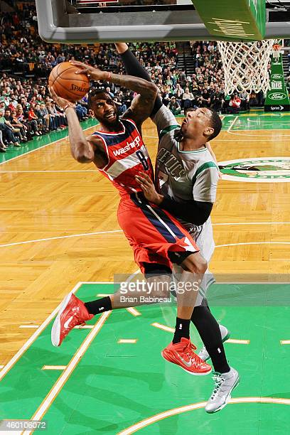 Rasual Butler of the Washington Wizards shoots against Jared Sullinger of the Boston Celtics on December 7 2014 at the TD Garden in Boston...