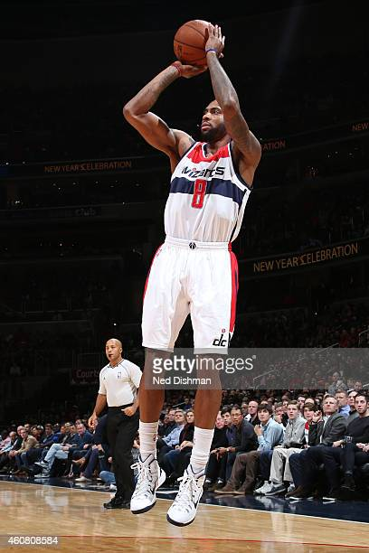 Rasual Butler of the Washington Wizards takes a shot against the Chicago Bulls on December 12 2014 in Washington DC NOTE TO USER User expressly...