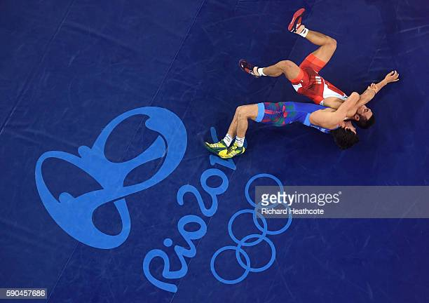 Rasul Chunayev of Azerbaijan competes against Hansu Ryu of Korea in the Men's GrecoRoman 66 kg Bronze final bout on Day 11 of the Rio 2016 Olympic...