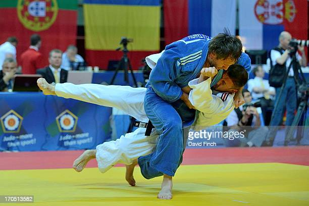 Rasul Sultanov of Azerbaijan throws JeanPhilippe Berthome of France for ippon to win their M2 u100kgs repercharge contest during the 2013 European...