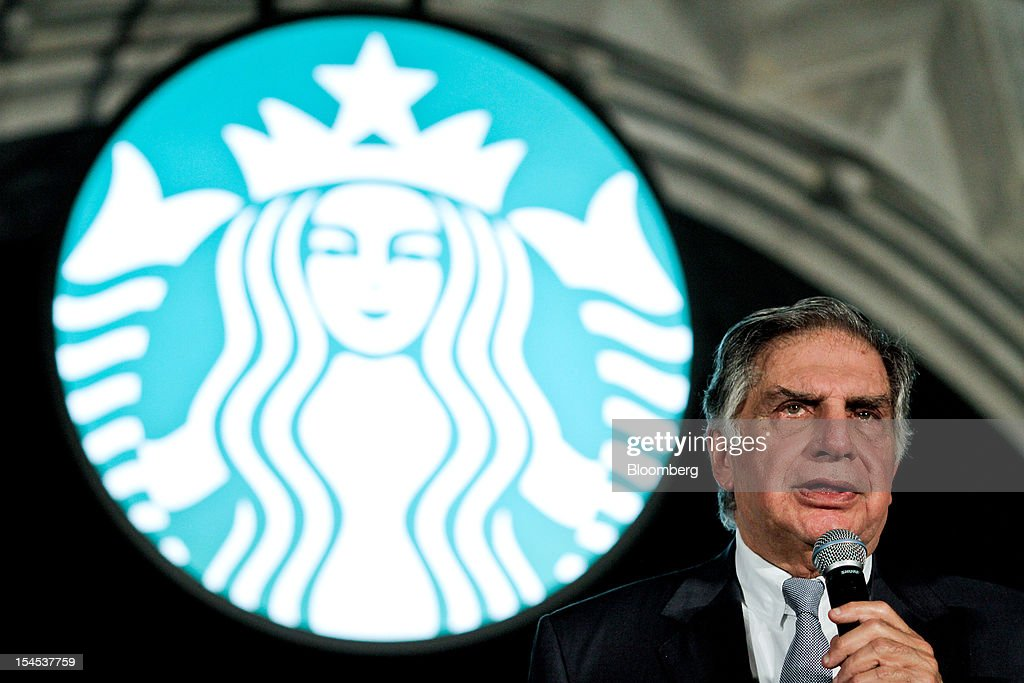 <a gi-track='captionPersonalityLinkClicked' href=/galleries/search?phrase=Ratan+Tata&family=editorial&specificpeople=649518 ng-click='$event.stopPropagation()'>Ratan Tata</a>, chairman of Tata Group, speaks in front of the Starbucks Corp. logo during the opening of the first Starbucks India outlet in Mumbai, India, on Friday, Oct. 19, 2012. Starbucks, which opened its first store in India today, will maintain its partnership with Tata Global Beverages Ltd. and plans to take some of that company's products to new markets, Starbucks' Chief Executive Officer Howard Schultz said. Photographer: Dhiraj Singh/Bloomberg via Getty Images