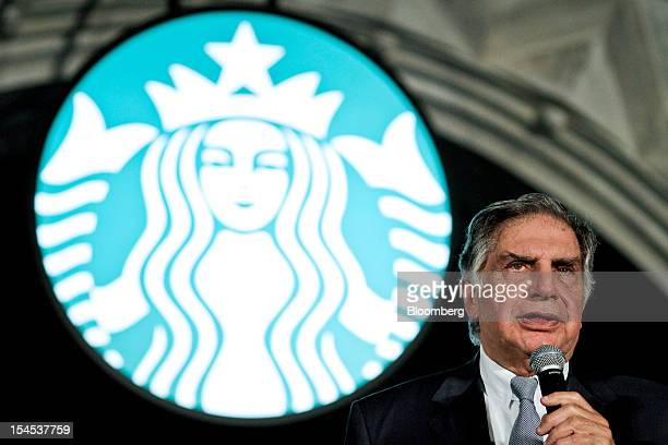 Ratan Tata chairman of Tata Group speaks in front of the Starbucks Corp logo during the opening of the first Starbucks India outlet in Mumbai India...