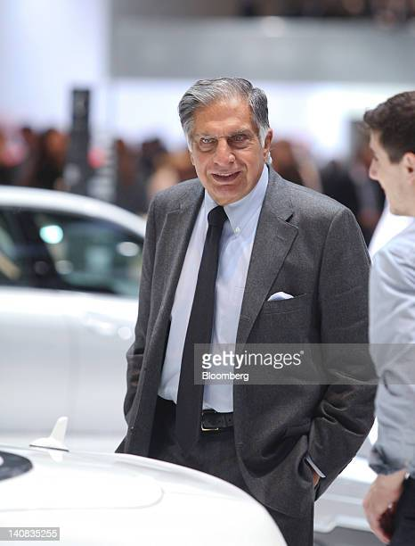 Ratan Tata chairman of Tata Motors Ltd left looks at automobile stands on the second press day of the Geneva International Motor Show in Geneva...