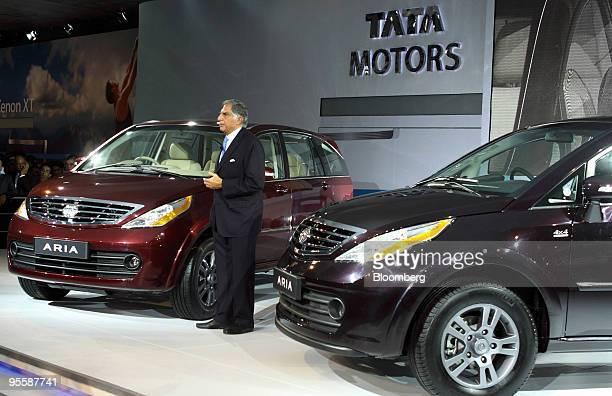 Ratan Tata chairman of Tata Sons Ltd speaks next to Tata Motors' Aria vehicles on display at the Auto Expo 2010 in New Delhi India on Tuesday Jan 5...