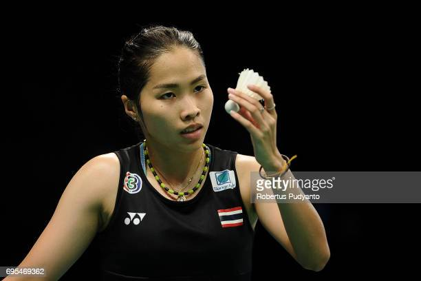 Ratchanok Intanon of Thailand competes against Saina Nehwal of India during Womens Single Round 1 match of the BCA Indonesia Open 2017 at Plenary...