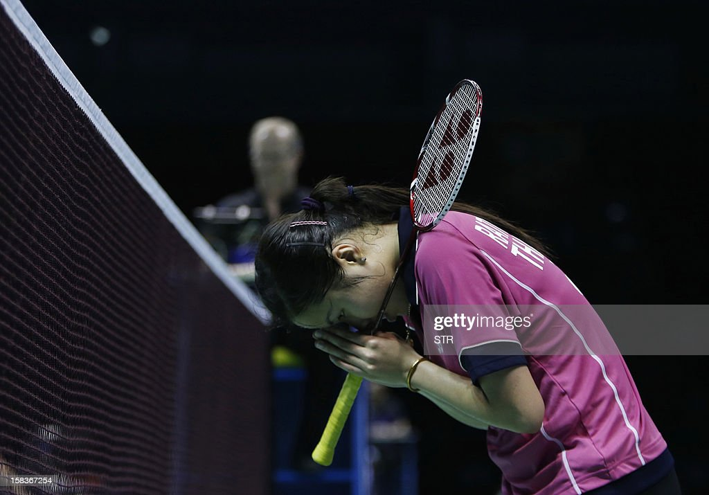 Ratchanok Intanon of Thailand gestures to the crowd after beating Tine Baun of Denmark in the women's singles event of the 2012 BWF Superseries Finals in Shenzhen, south China's Guangdong province on December 14, 2012. Ratchanok beat Baun 21-15, 21-14 to move into the next round.