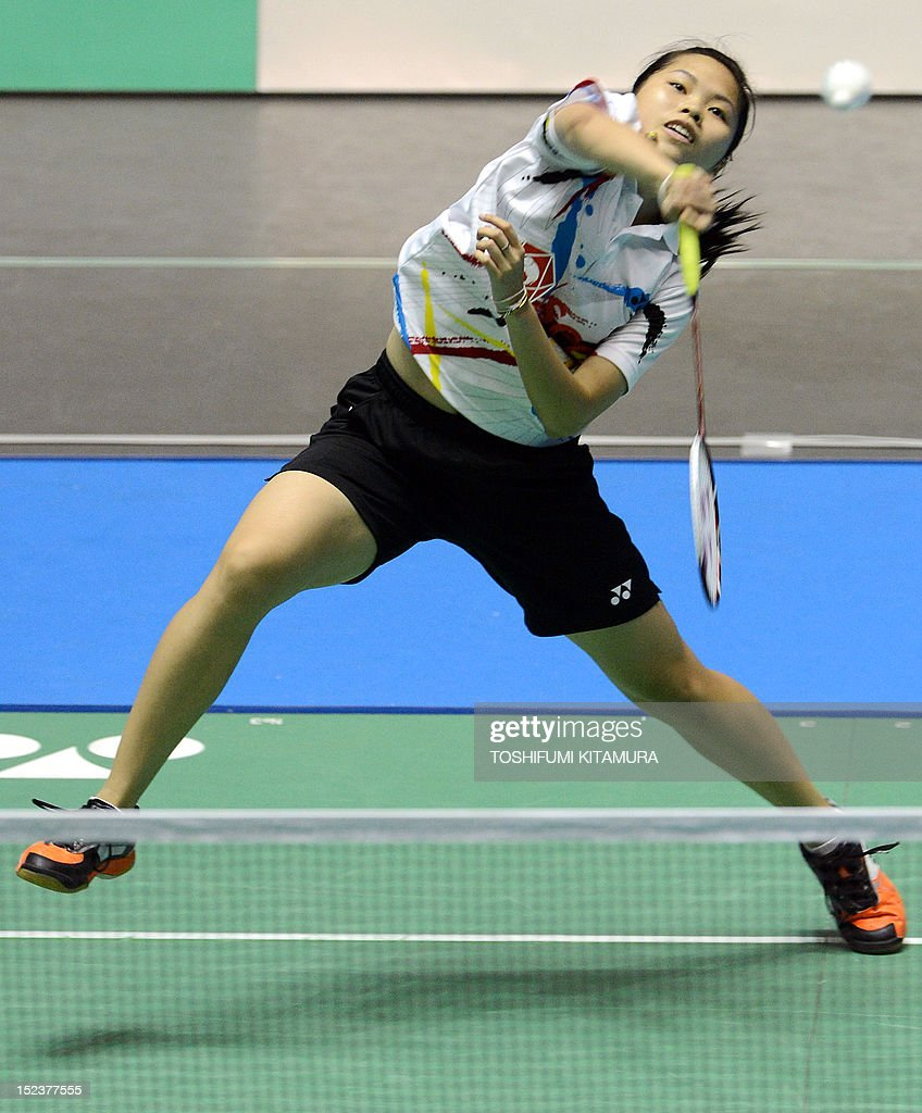 Ratchanok Intanon of Thailand hits a return against Tee Jing Yi of