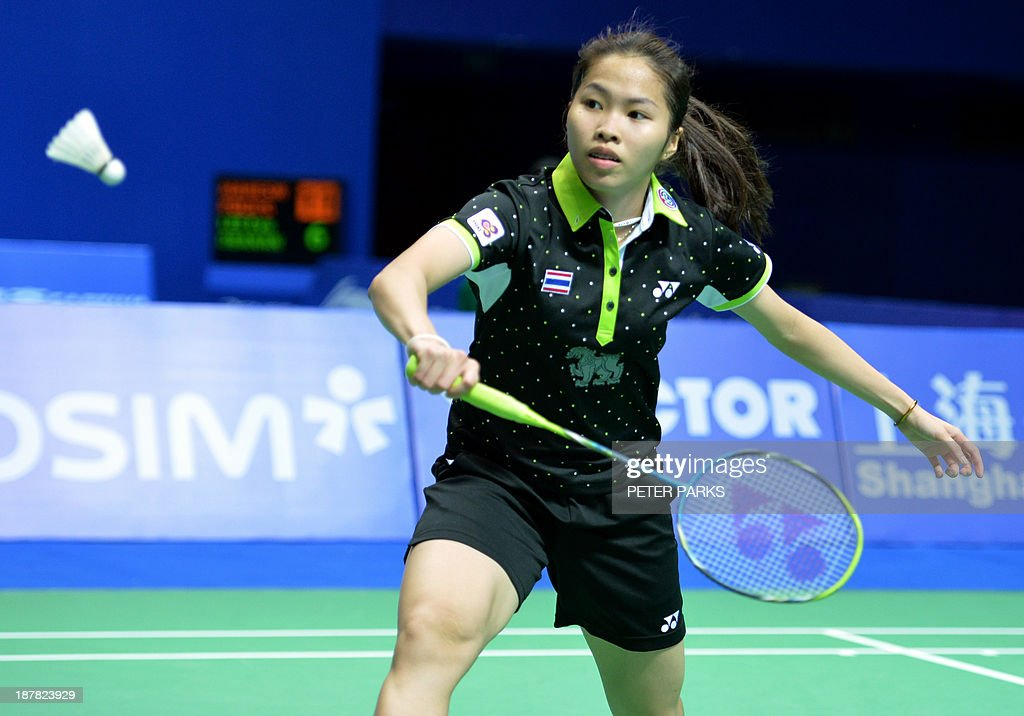 Ratchanok Intanon of Thailand hits a return to Xiao Jia Chen of China in the women's singles first round at the China Open badminton tournament in Shanghai on November 13, 2013. Ratchanok won the match 16-21, 21-14, 21-8. AFP PHOTO/Peter PARKS