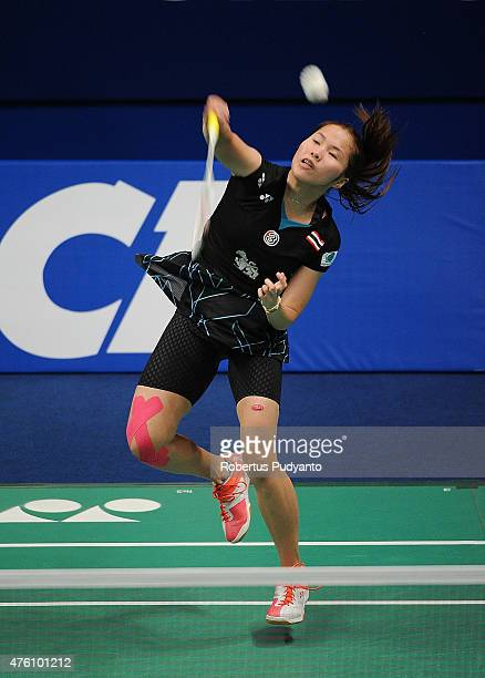 Ratchanok Intanon of Thailand plays a shot against Wang Shixian of China during the 2015 BCA Indonesia Open Semifinals match at Istora Senayan on...