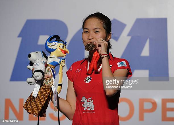 Ratchanok Intanon of Thailand poses on the podium after winning Women's Final against Yui Hashimoto of Japan during the 2015 BCA Indonesia Open at...