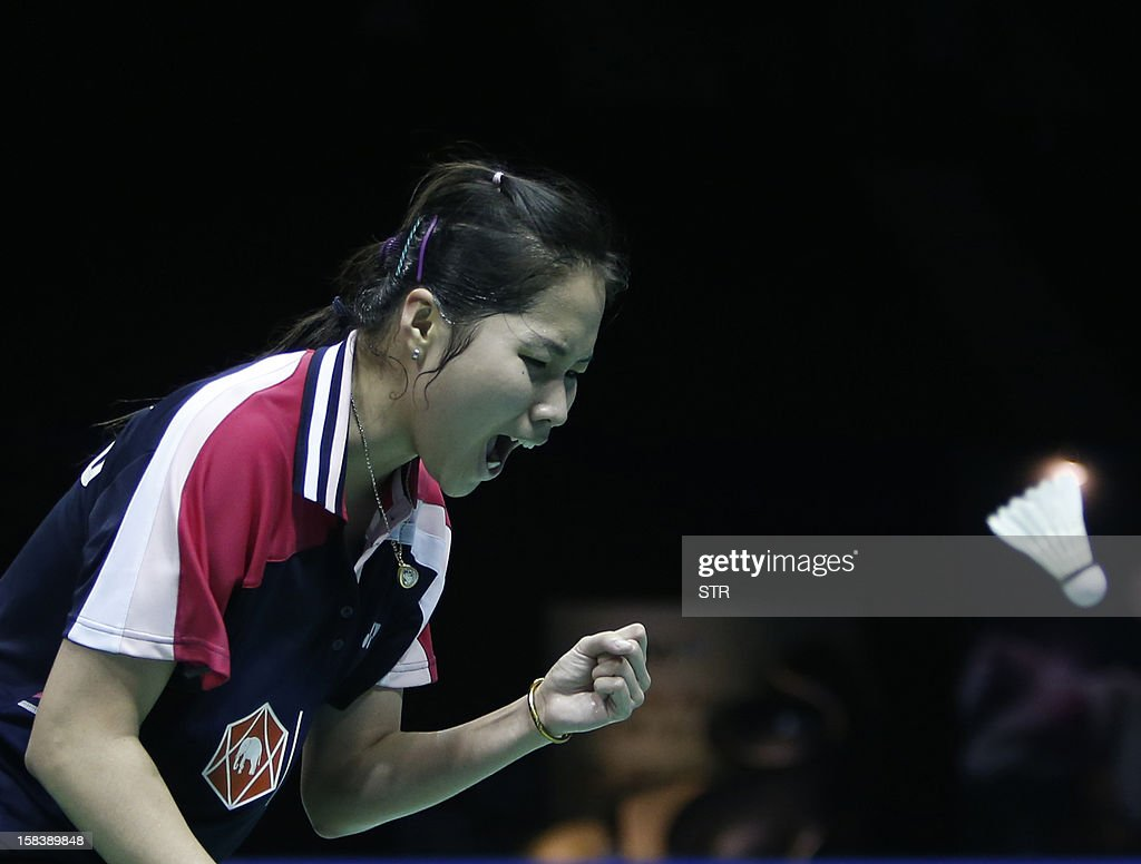 Ratchanok Intanon of Thailand reacts after winning a point against Wang Shixian of China in the women's singles event of the 2012 BWF Superseries Finals in Shenzhen, south China's Guangdong province on December 15, 2012. Wang beat Ratchanok 21-12, 21-19 to move into the final.