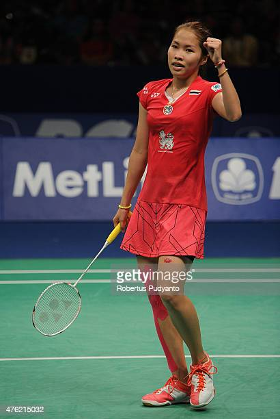 Ratchanok Intanon of Thailand reacts after winning Women's Final against Yui Hashimoto of Japan during the 2015 BCA Indonesia Open at Istora Senayan...