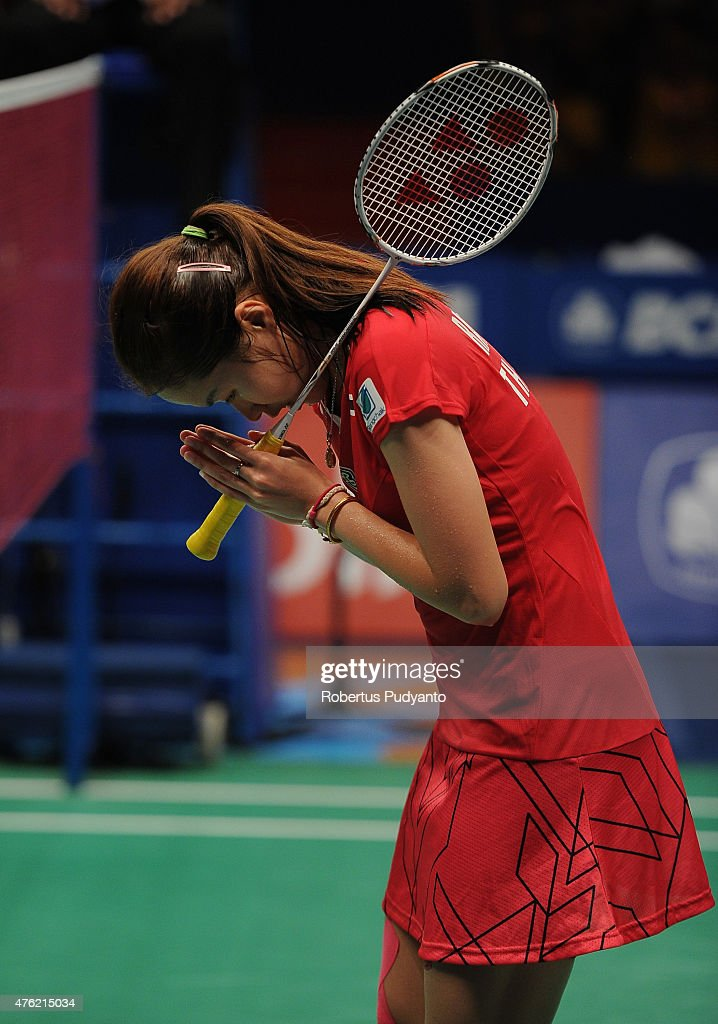 <a gi-track='captionPersonalityLinkClicked' href=/galleries/search?phrase=Ratchanok+Intanon&family=editorial&specificpeople=6597063 ng-click='$event.stopPropagation()'>Ratchanok Intanon</a> of Thailand reacts after winning Women's Final against Yui Hashimoto of Japan during the 2015 BCA Indonesia Open at Istora Senayan on June 7, 2015 in Jakarta, Indonesia.