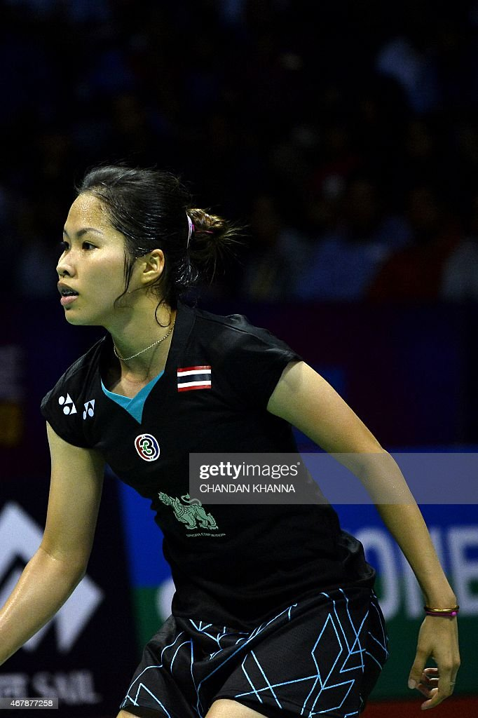<a gi-track='captionPersonalityLinkClicked' href=/galleries/search?phrase=Ratchanok+Intanon&family=editorial&specificpeople=6597063 ng-click='$event.stopPropagation()'>Ratchanok Intanon</a> of Thailand reacts to a shot against Carolina Marin of Spain during the women's singles badminton semi final match at the Yonex-Sunrise India Open 2015 at the Siri Fort Sports Complex in New Delhi on March 28, 2015. AFP PHOTO / Chandan KHANNA