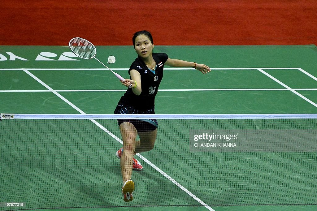 <a gi-track='captionPersonalityLinkClicked' href=/galleries/search?phrase=Ratchanok+Intanon&family=editorial&specificpeople=6597063 ng-click='$event.stopPropagation()'>Ratchanok Intanon</a> of Thailand returns a shot against Carolina Marin of Spain during the women's singles badminton semi final match at the Yonex-Sunrise India Open 2015 at the Siri Fort Sports Complex in New Delhi on March 28, 2015. AFP PHOTO / Chandan KHANNA