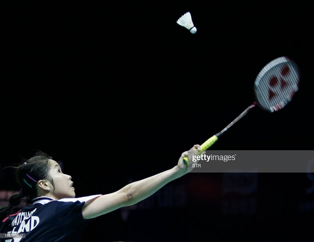 Ratchanok Intanon of Thailand returns a shot against Wang Shixian of China in the women's singles event of the 2012 BWF Superseries Finals in Shenzhen, south China's Guangdong province on December 15, 2012. Wang beat Ratchanok 21-12, 21-19 to move into the final.
