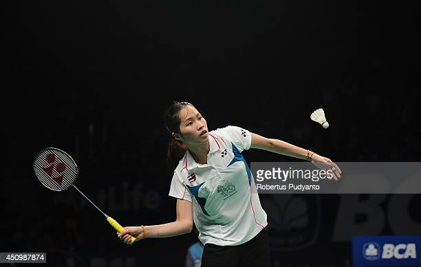 Ratchanok Intanon of Thailand returns a shot against Wang Shixian of China during the semifinal BCA Indonesia Open 2014 MetLife BWF World Super...