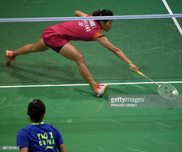 Ratchanok Intanon of Thailand returns a shot against Yao Xue of China during their women's singles badminton quarterfinal match at the YonexSunrise...
