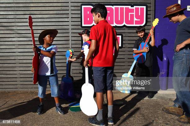 Rathamile Radebe Mani Mirzamohannati and friends play with props during the Tamworth Country Music Festival Cavalcade on January 28 2017 in Tamworth...