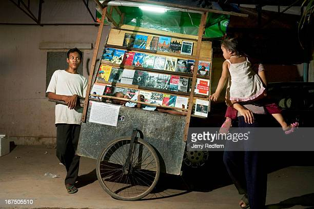 Rathana cares for his brother Ratha while running the Hello Bookshop book cart in the old town area of Siem Reap Rathana says he is the eldest of six...