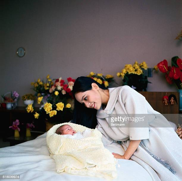 Ratna Sari Dewi Japanese wife of former Indonesian President Sukarno holds her 2 week old daughter named Katika Sari'Essence of the Star' is shown in...