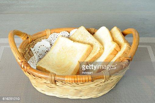 Rattan bread basket on gray napery : Foto de stock