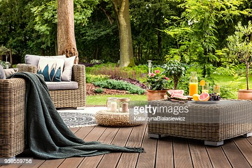 Rattan table with fruit : Stock Photo