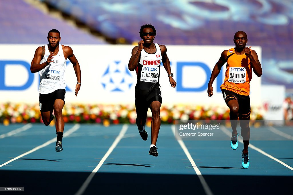 Ratu Banuve Tabakaucoro of Fiji Tremaine Harris of Canada and Churandy Martina of the Netherlands compete in the Men's 200 metres heats during Day...
