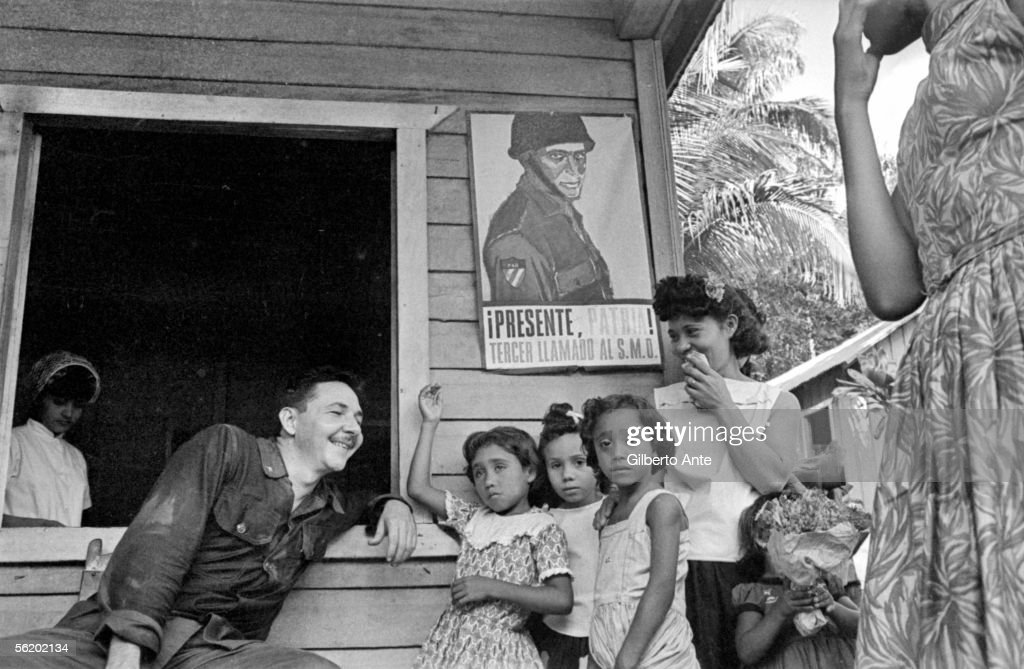 Rauel Castro talking with a family of countrymen. Cuba, 1964.