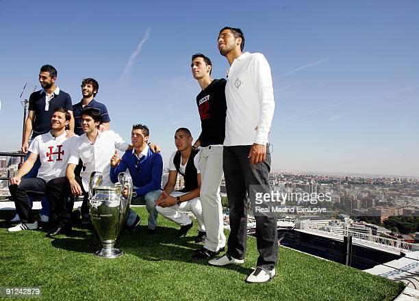 Raul Albiol Esteban Granero Xabi Alonso Kaka Cristiano Ronaldo Karim Benzema Alvaro Arbeloa and Ezequiel Garay of Real Madrid poses with a European...