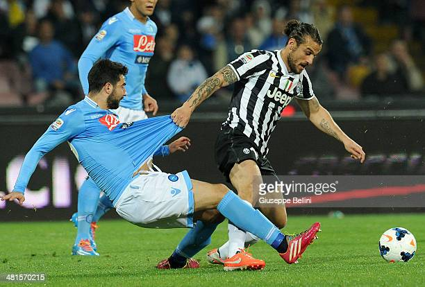 Raul Albiol of Napoli and Pablo Osvaldo of Juventus in action during the Serie A match between SSC Napoli and Juventus at Stadio San Paolo on March...