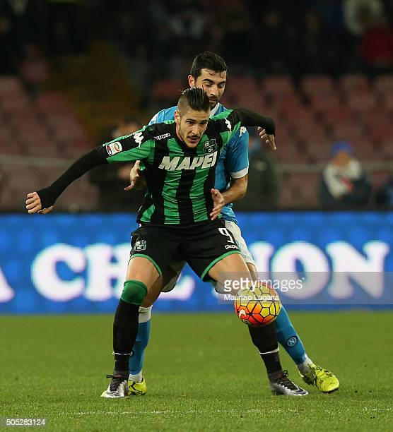 Raul Albiol of Napoli competes for the ball with Diego Falcinelli of Sassuolo during the Serie A match between SSC Napoli and US Sassuolo Calcio at...